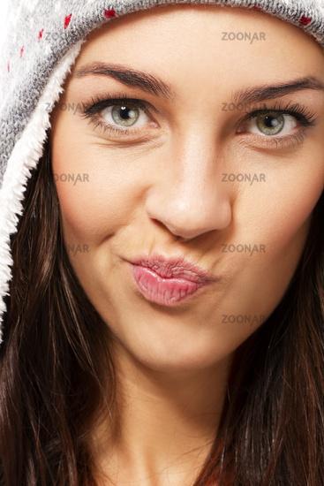 beautiful brunette woman making puss face
