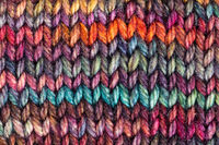 pied hand-knitted woolen fabric close up