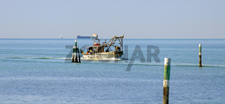 Fischerboot auf der Heimfahrt