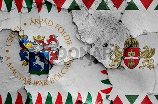 flags of District XXI. (Csepel) and Budapest painted on cracked wall