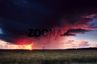 dramatic thunderstorm at sunset