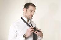 Handsome guy adjusts his tie