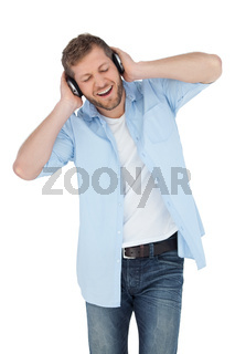 Trendy model listening to music