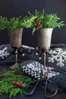 Cut cedar in old wine goblets for holiday decoration