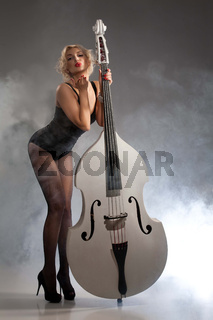 Young Woman In Lingerie With A Double Bass