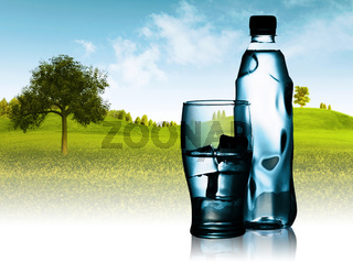 Spring mineral water bottled with glass and ice against natural landscape