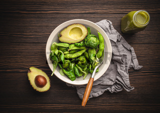 Green healthy salad and smoothie