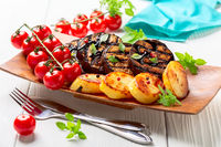 Delicious eggplant steaks with vegetables.