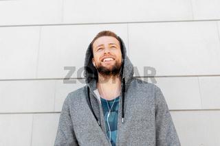 man in earphones listening to music outdoors