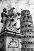 Leaning Tower of Pisa and sculpture angels