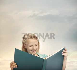 Little Girl Reading a Big Book