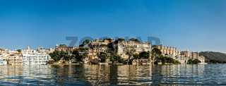 India luxury tourism concept background - panorama of Udaipur City Palace from Lake Pichola. Udaipur