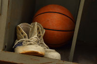Old sport sneakers shoes and basketball ball