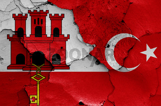 flags of Gibraltar and Turkey painted on cracked wall