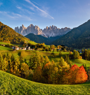 Autumn evening Santa Magdalena famous Italy Dolomites village view in front of the Geisler or Odle Dolomites mountain rocks.