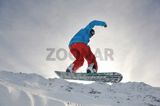 happy young man have fun at winter on mountain peak