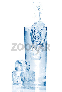 Water splash in glasse with ice isolated on white