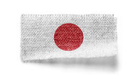 Japan flag on a piece of cloth on a white background
