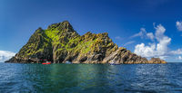 Large panorama with cruise boats docking to Skellig Michael island, where Star Wars were filmed