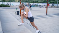 Female jogger lunging on steps