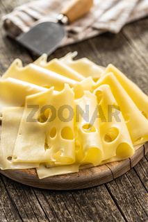 Sliced hard cheese.