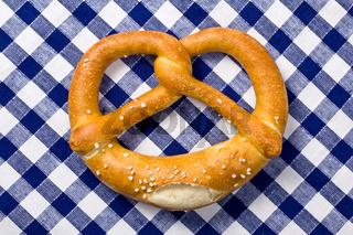 pretzel on checkered napkin