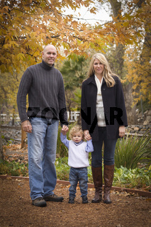 Young Attractive Parents and Child Portrait in Park