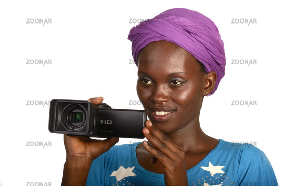 Pretty african girl with scarf with video camera