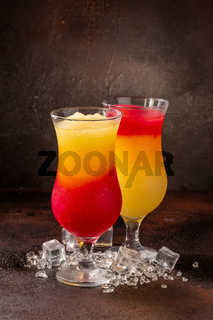 Delicious cold refreshing colorfull smoothie drinks in cocktail glases with fruits