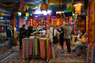 Buyers in colored fabric shop in Fes