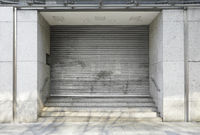 closed department store with rolling shutters - business closure