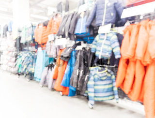 blurred sport and travel hypermarket aisle