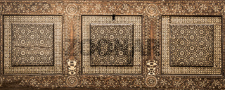 Antique art of wood decoration on a 15th century Italian furniture. Vintage and gothic background.