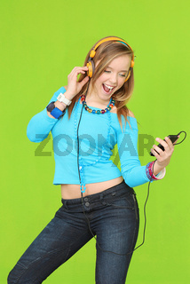 teen with headphones listening to music