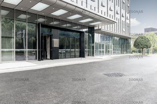 modern office building with asphalt ground