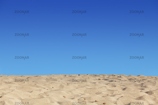 beach blue sky and sand background