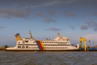 Ferry at the coast of Dagebuell in evening light, North Sea, North Frisia, Germany