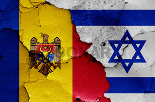 flags of Moldova and Israel painted on cracked wall