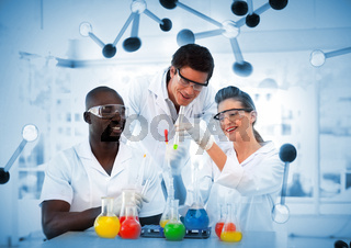 Group of chemist examining test tubes