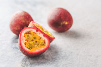 Organic raw passion fruit on kitchen table.