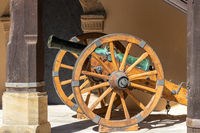 Old cannon on spoked wheels at Veste Coburg