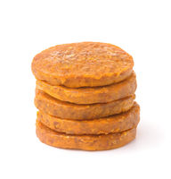 Stack of organic dried apricot and almond discs dessert