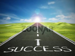 Asphalt road with arrow and success text against blue sky