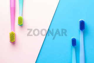 New Toothbrushes On Pink And Blue Paper