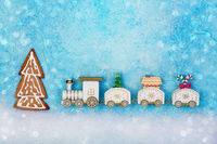 Christmas toy train with a Christmas tree and gifts.