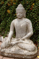 Stone Buddha in the lotus position.