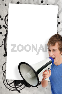 Young man shouting through megaphone in front of copy space