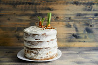 Carrot cake on a plate on wooden background