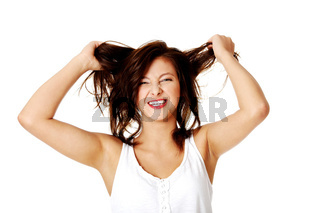 Young smiling girl pulling her hair.