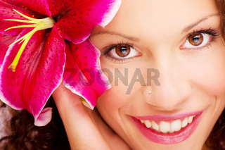 woman's eyes and flower